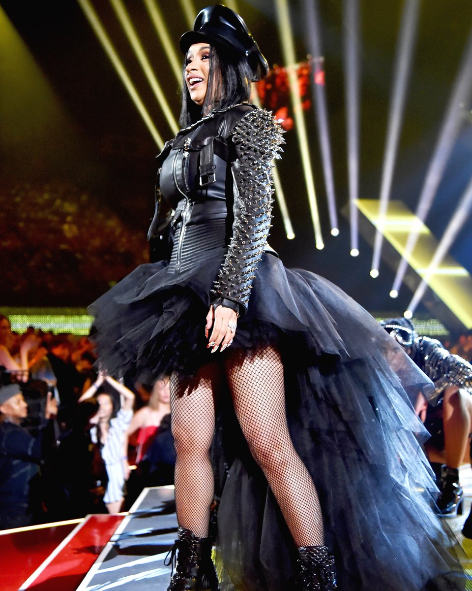 Cardi B performing at the 2018 iHeart Radio Music Awards in Moschino