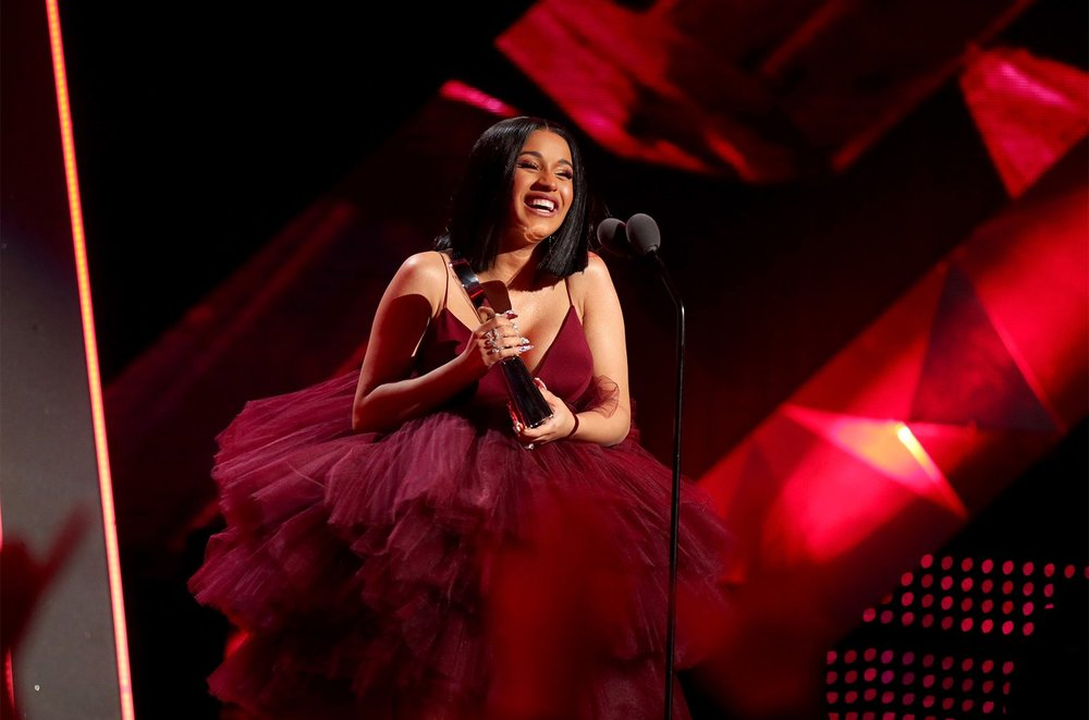 Cardi B Accepting her Best New Artist Award at the 2018 iHeart Radio Music Awards in Fall 2018 Christian Siriano
