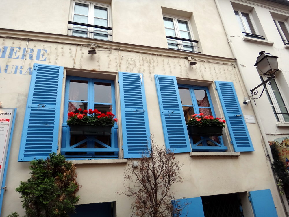 photo credit: Carolyn Marquardt  / Blue shutters and flowers in Paris