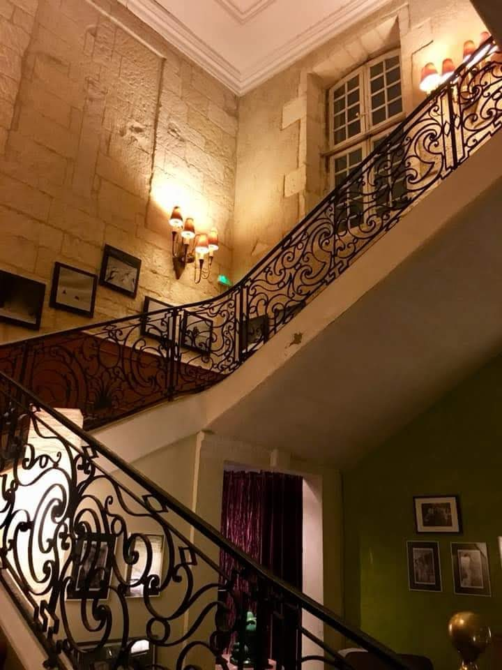 Elegant staircases add charm and grace to otherwise modest accommodations featuring a dearth of electrical outlets