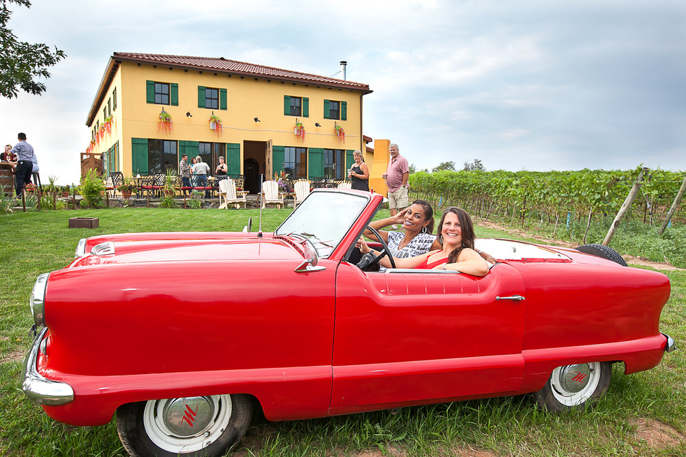 "In front of the main building they have a ""1954 Nash Metropolitan"" for guests to enjoy and get pictures with during their visit to Bent Ridge Winery. These ladies helped me out in a few photos that afternoon."