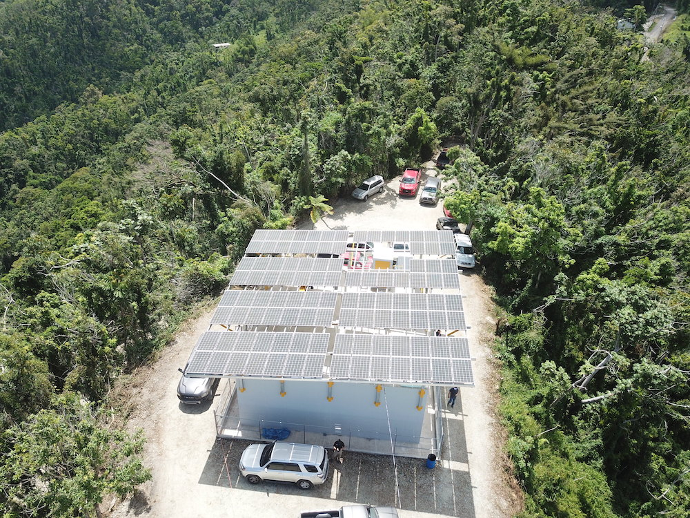 After deciding to install solar, the Montellanos community built the infrastructure to mount the panels directly on top of the water tank for the town, demonstrating committed ownership of the project.