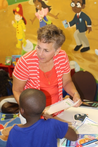 Karen Morrow, with a child in the Hope Library