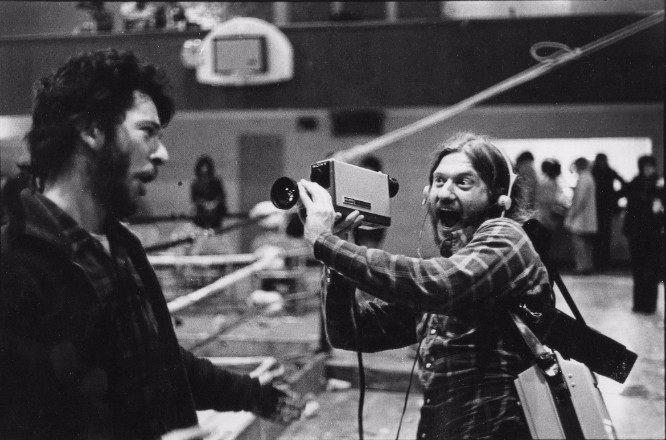 Videofreex Bart Friedman and Skip Blumberg, wearing a Sony PortaPack, in production