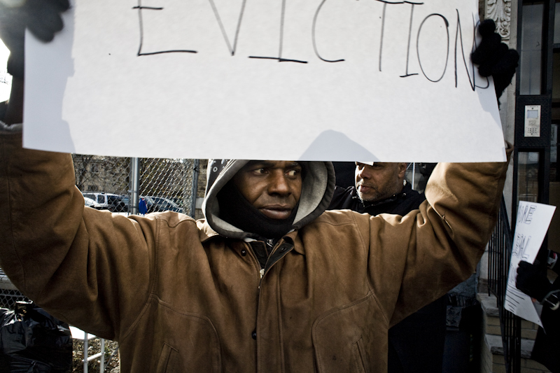 man at protest hold sign.jpg