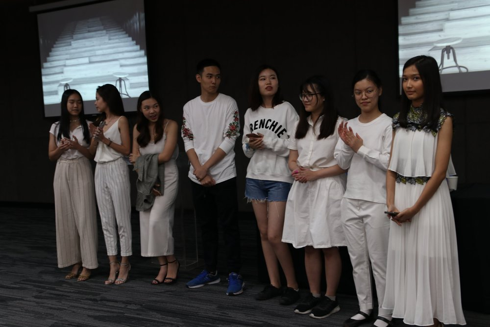 """The artists (from left to right): Yeewa, Kiara, Jean, Prin, Joanna, Monet, Claire, Thinzar  Photograph credit to Pongpichet """"Dew"""" Piyaman."""