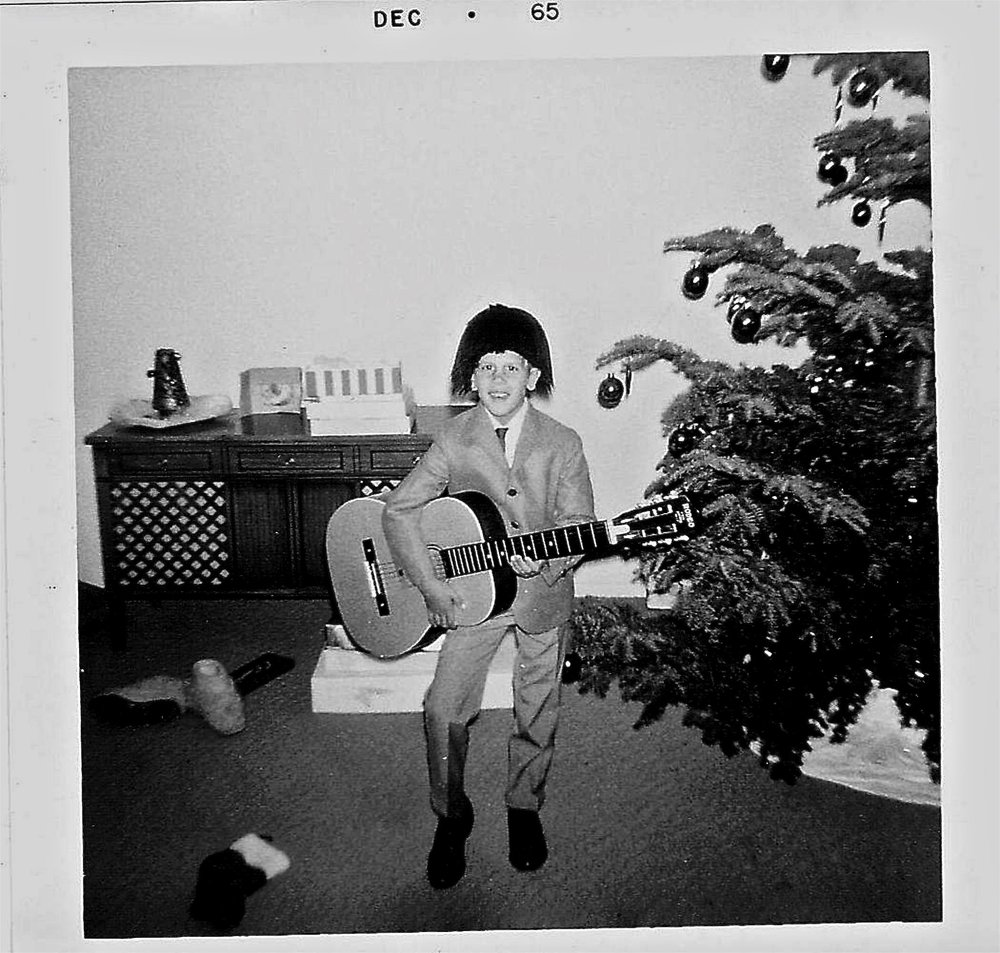 "Eric Henderson at a young age wearing a ""Beatles Wig"""