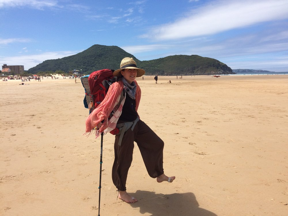 I couldn't help but show this joyful picture of myself on the Northern Camino de Santiago this past summer, happy to be on a beach giving my blistered feet a break