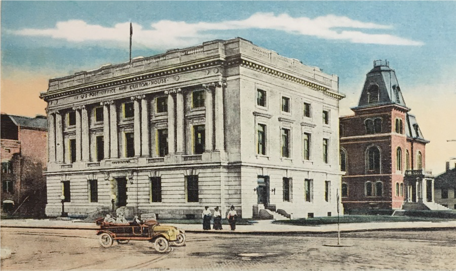 Courtesy Special Collections, University of Vermont   This 1910 hand colored photo shows; to the right, the redstone courthouse that served Chittenden County for over one hundred years. To its left is the present marble courthouse, formerly the U. S. Post Office and Customs House.