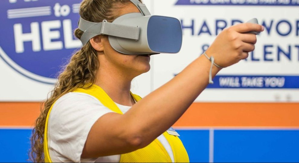 Image of a Walmart employee wearing an Oculus Go virtual reality headset on Digital Worlds VR Aracde website in Franklin TN.