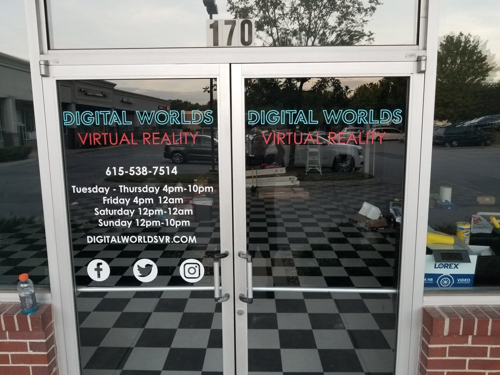 Image Showing Digital Worlds VR Arcade Door Signs With Virtual Reality Franklin Tennessee Open Hours