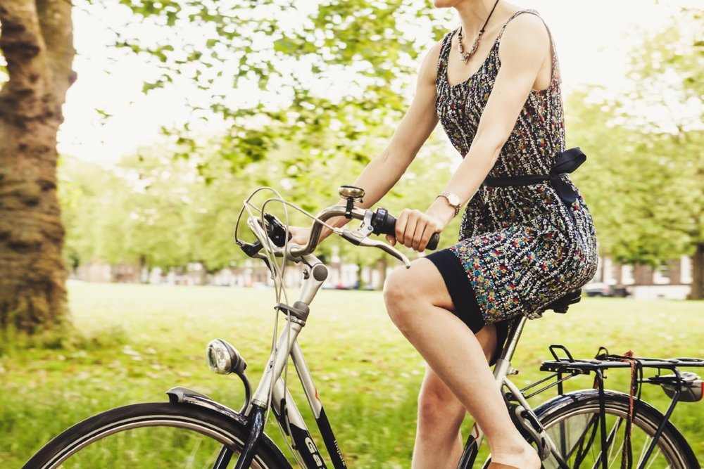 woman-riding-bike-through-park.jpg