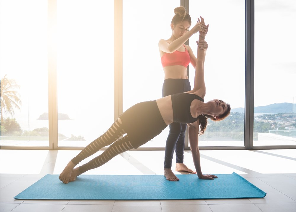 Private Yoga Teacher with Client