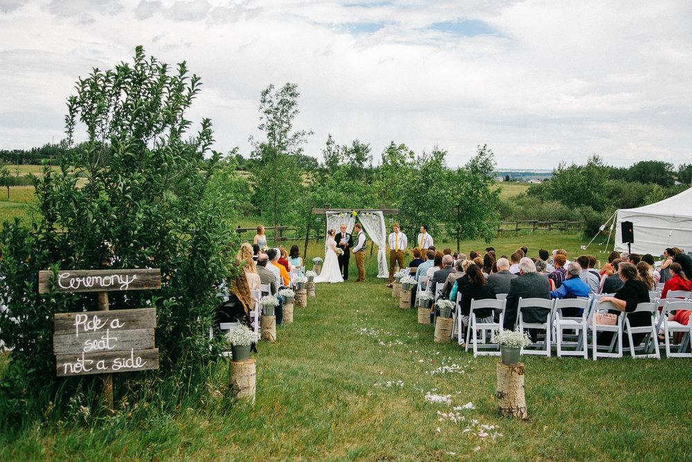 okotoks-wedding-photographer-love-and-be-loved-photography-sara-luke-backyard-ceremony-photo-image-picture-96.jpg