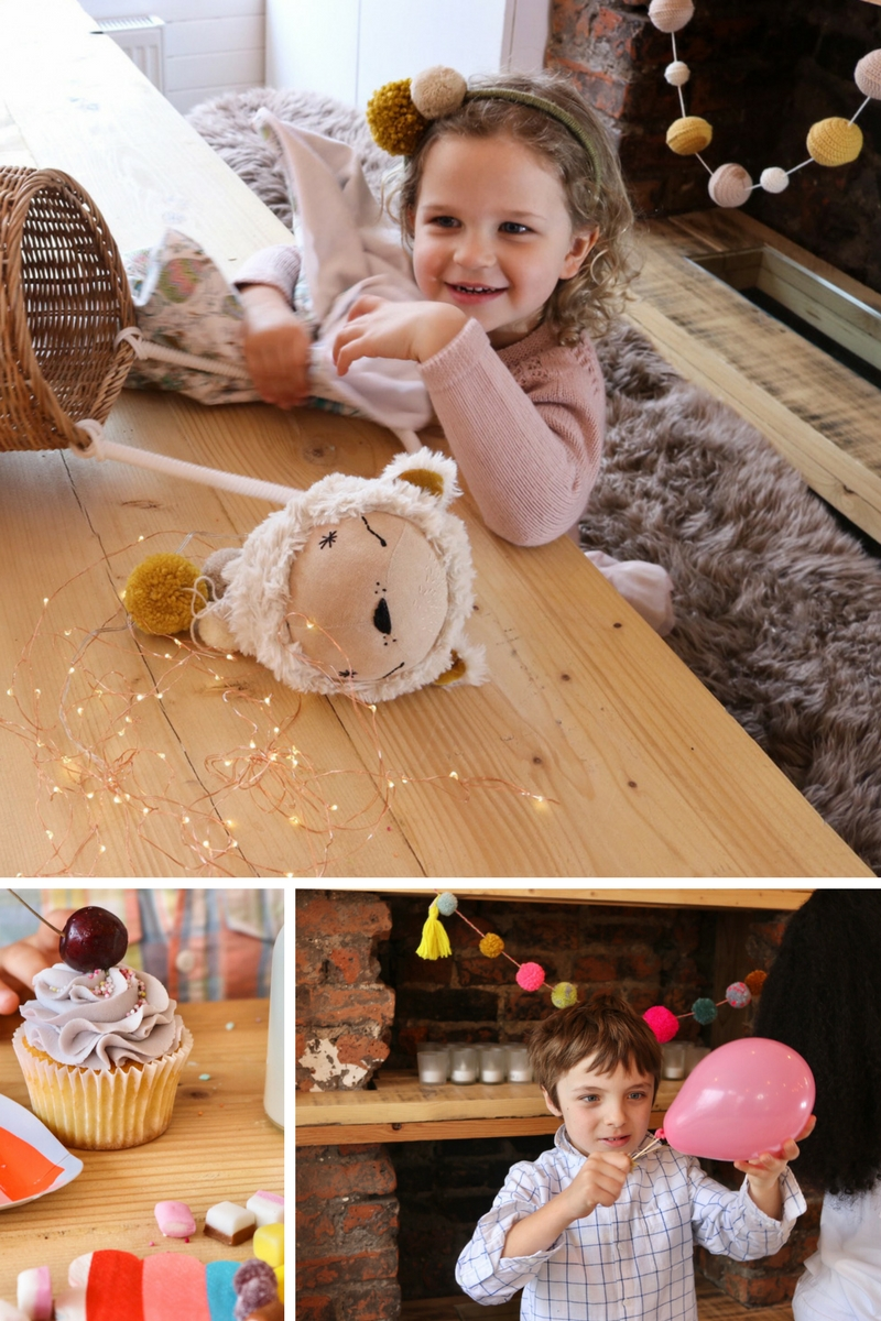 Clockwise from top: Garlands by My Mini Studio, headband by Lala and Pom, toys by Beyond the Stork, cake by Sucre a la Creme bakery