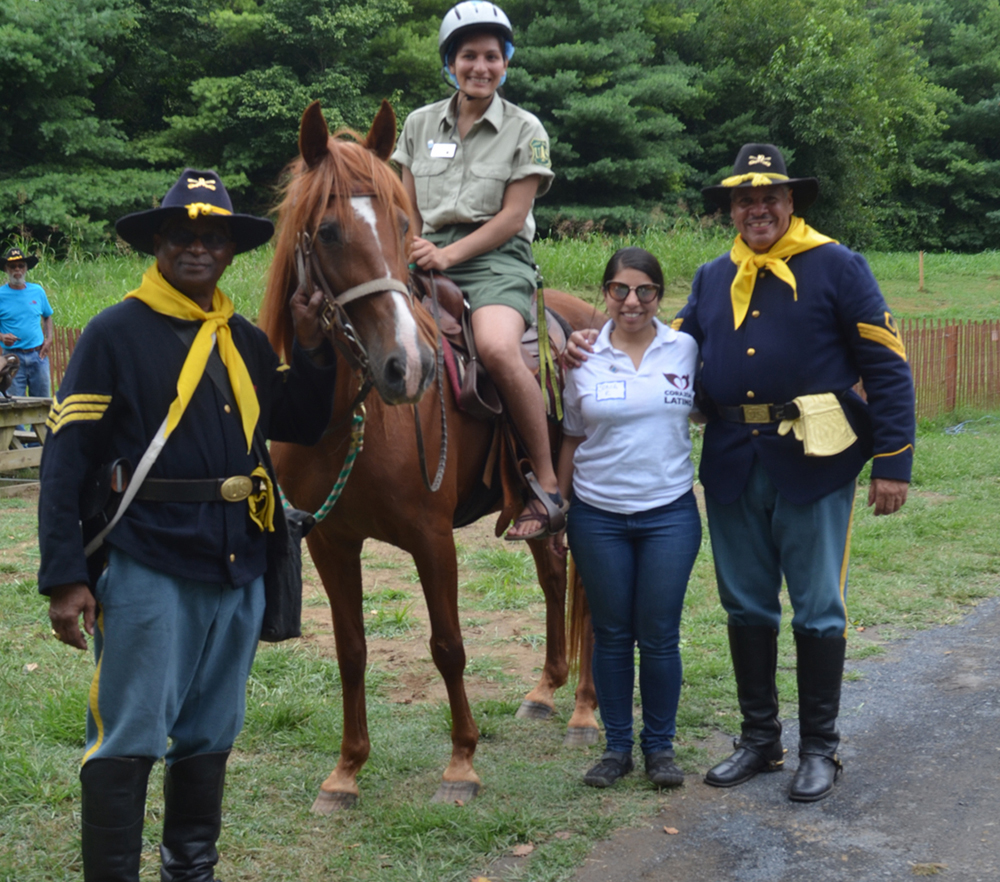 Buffalo Soldiers teaching horseback riding basics!