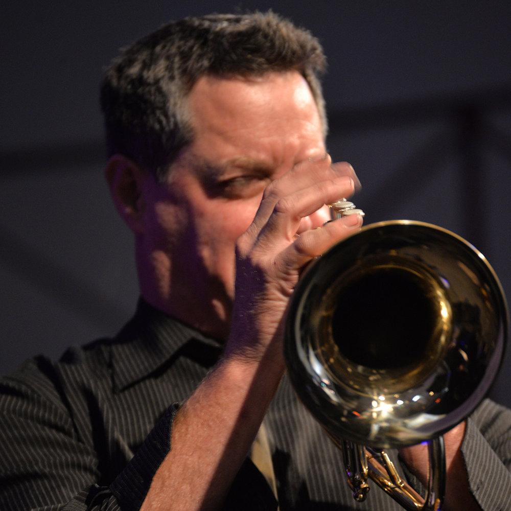 Man blasting trumpet