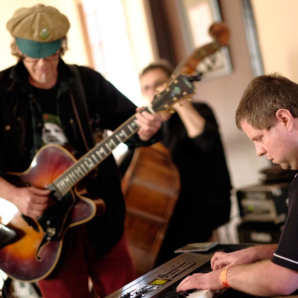 Guitarist, double-bass player and drummer