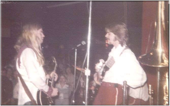 Gregg Allman with our bass player Chuck, taken with my Instamatic camera.