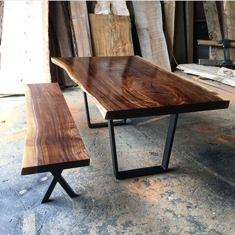 Black walnut dining table with bench on steel legs