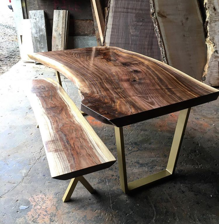 Black walnut dining table with bench on powder coated steel legs