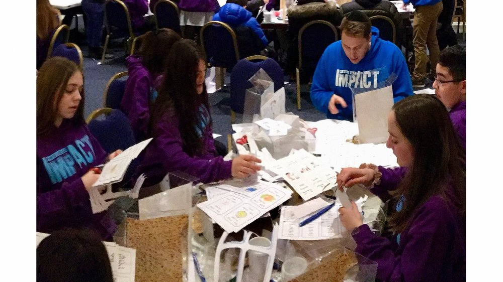 Making boxes for Chai and Camp Simcha seriously ill children