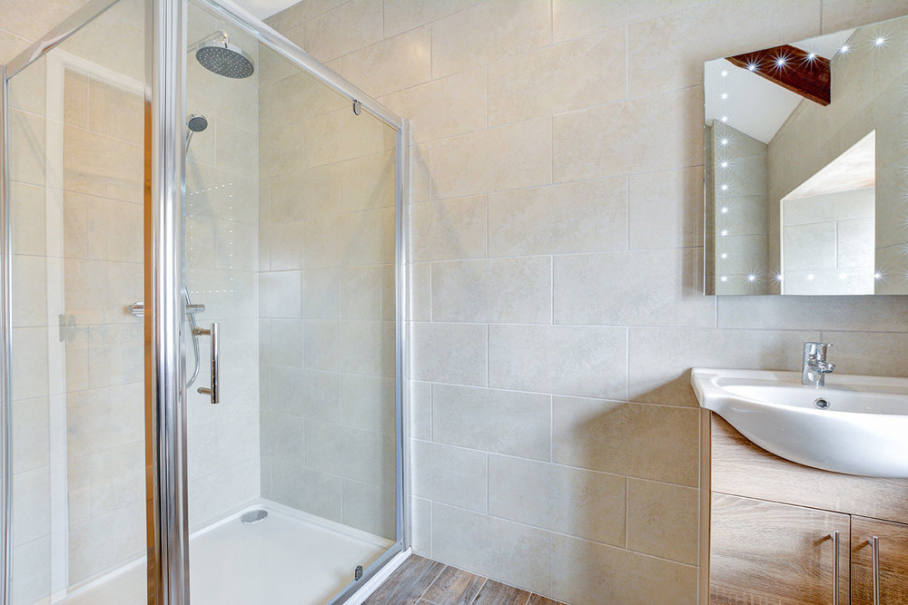 The bathroom of Otterbridge luxury self catering converted barn holiday cottage at Penrose Burden in North Cornwall.jpg