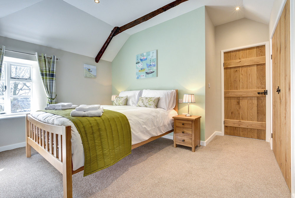 The second bedroom of Otterbridge luxury self catering converted barn holiday cottage at Penrose Burden in North Cornwall01.jpg