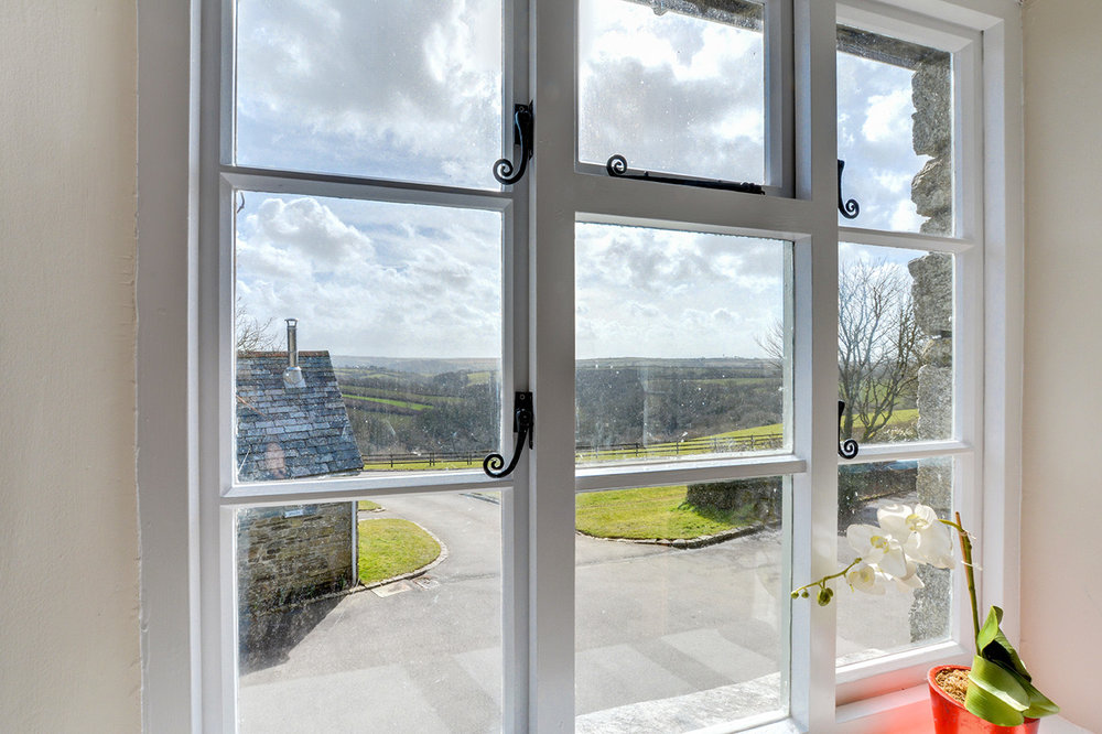 View from the lounge of Otterbridge luxury self catering converted barn holiday cottage at Penrose Burden in North Cornwall.jpg
