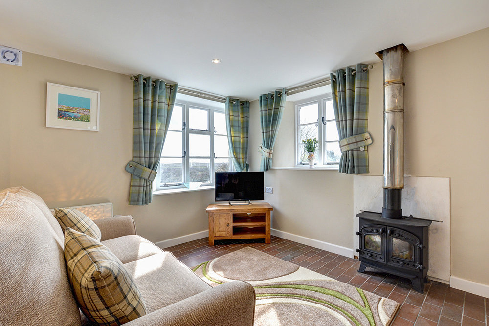 The lounge of Butterwell luxury self catering converted barn holiday cottage at Penrose Burden in North Cornwall 02.jpg
