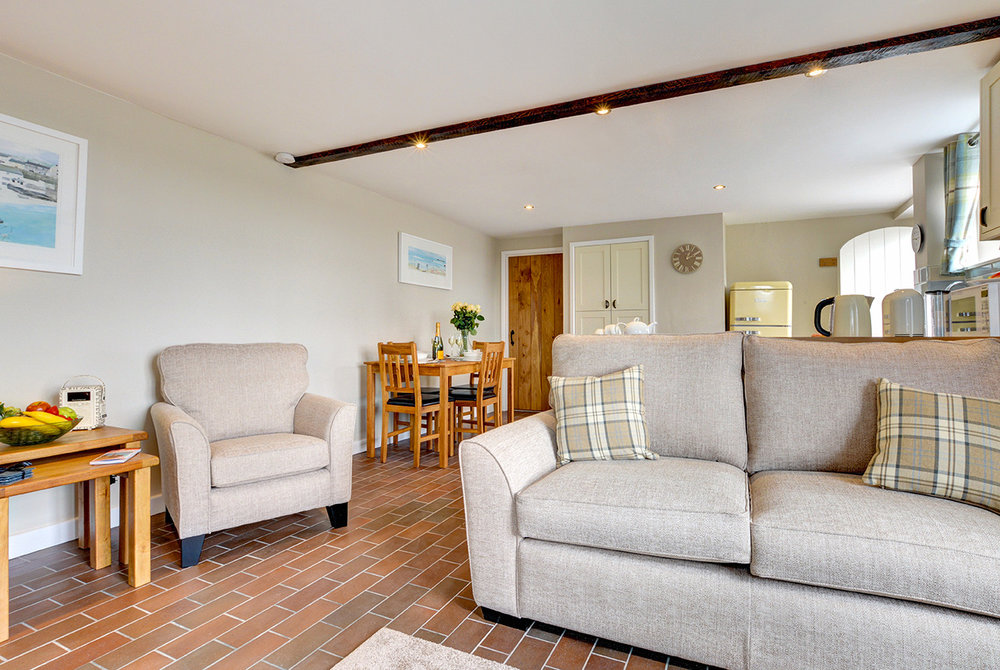 The lounge of Butterwell luxury self catering converted barn holiday cottage at Penrose Burden in North Cornwall 03.jpg