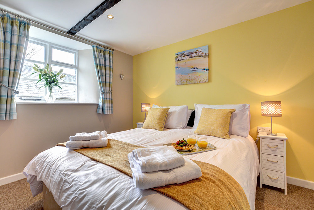 Bedroom one of Butterwell luxury self catering converted barn holiday cottage at Penrose Burden in North Cornwall 01.jpg