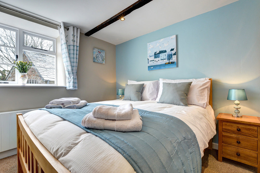 Bedroom two of Butterwell luxury self catering converted barn holiday cottage at Penrose Burden in North Cornwall 02.jpg