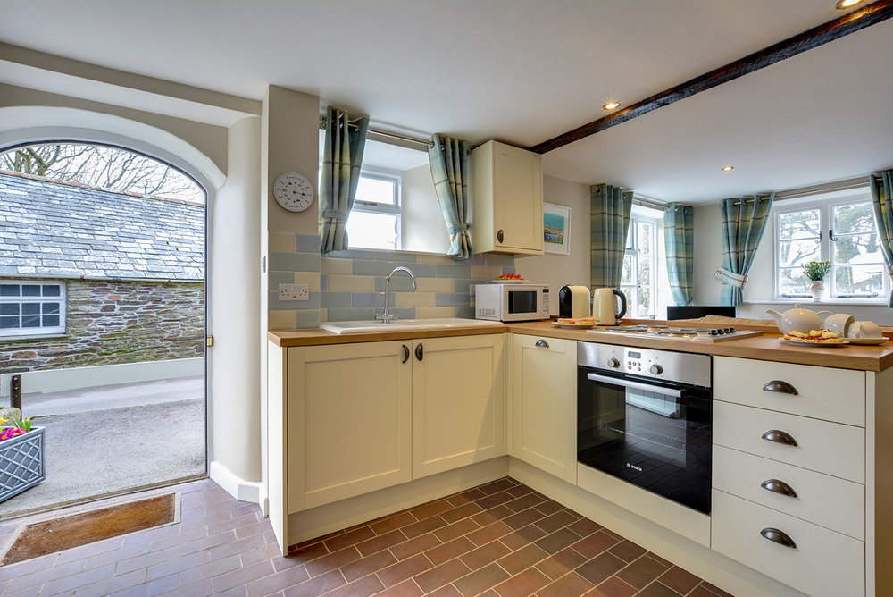 The kitchen of Butterwell luxury self catering converted barn holiday cottage at Penrose Burden in North Cornwall 01.jpg