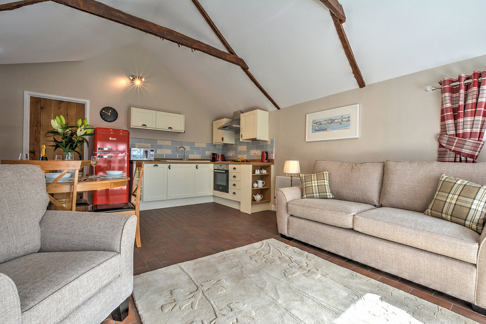 The open plan living room of Goosehill luxury self catering converted barn holiday cottage at Penrose Burden in North Cornwall 01.jpg