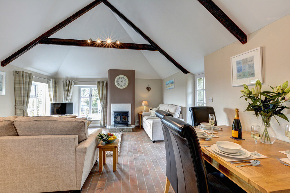 The dining area of Otterbridge luxury self catering converted barn holiday cottage at Penrose Burden in North Cornwall.jpg