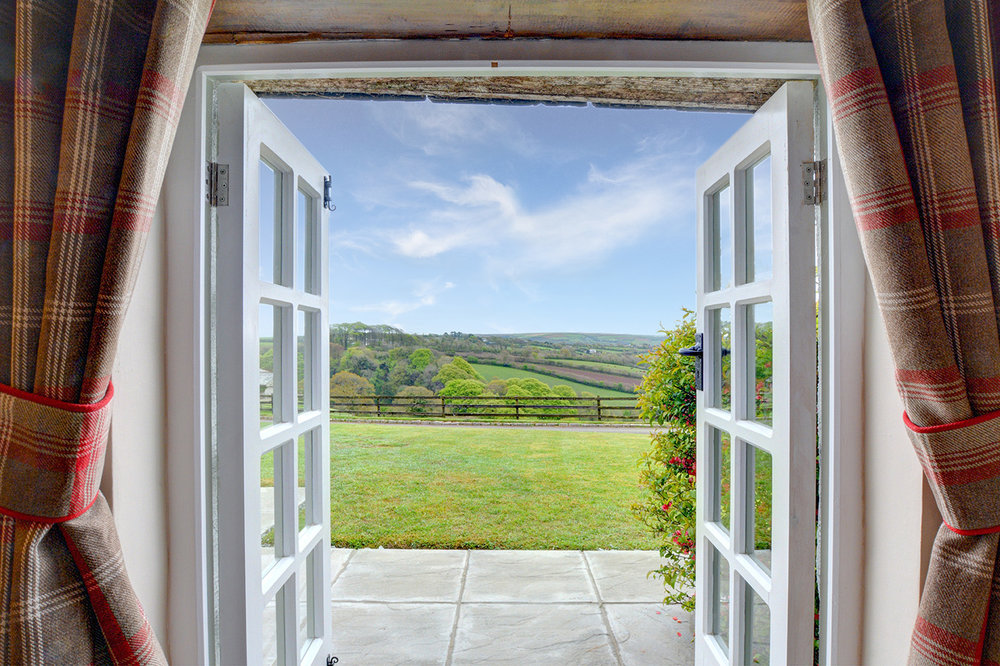 The view from the patio doors of The Linney self catering cottage converted barn at Penrose Burden holiday cottages in Cornwall.jpg