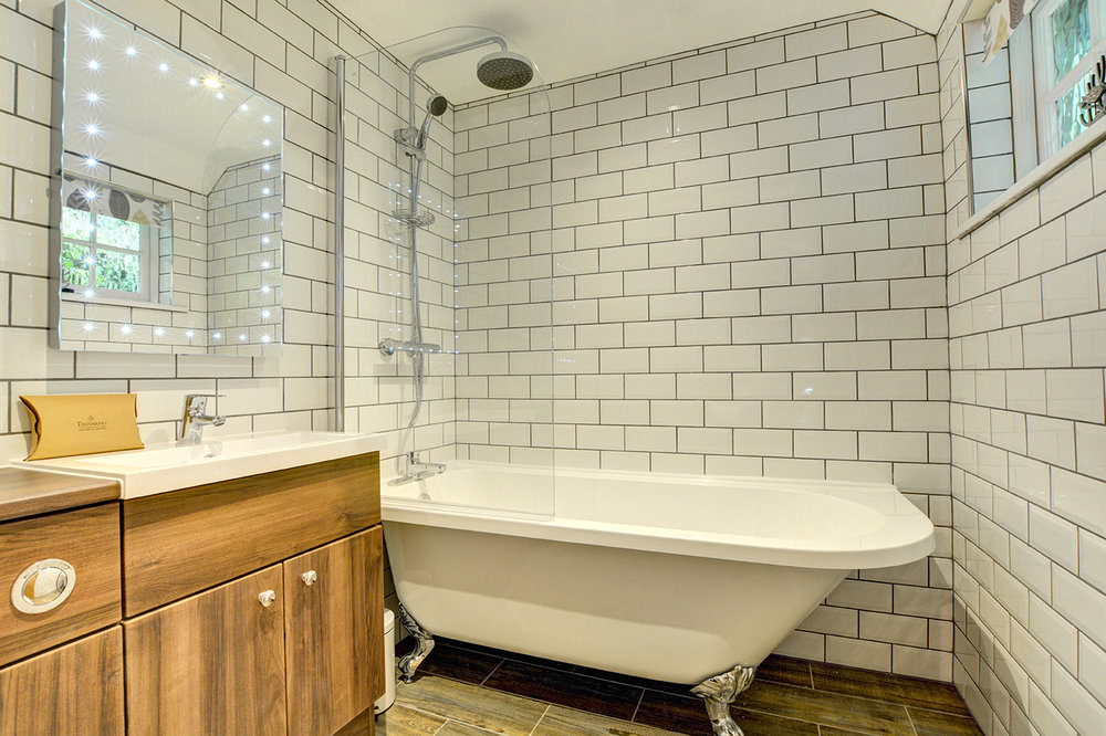 The luxury bathroom of The Linney self catering cottage converted barn at Penrose Burden holiday cottages in Cornwall.jpg