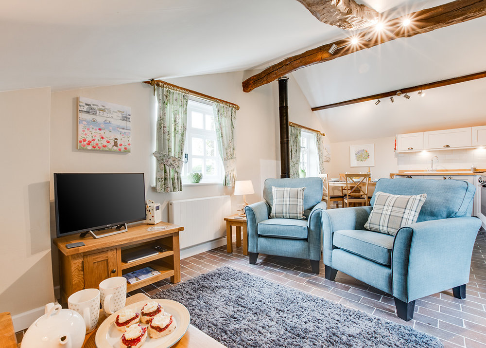 The lounge area of Snappers luxury self catering converted barn holiday cottage at Penrose Burden in North Cornwall 02.jpg