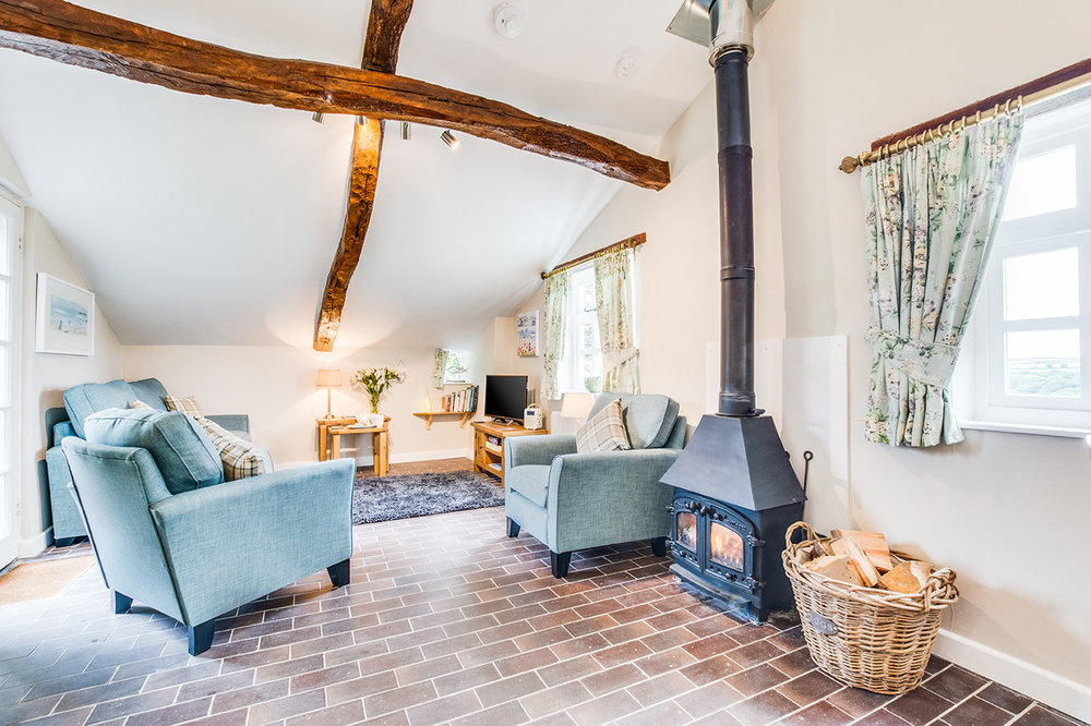 The lounge area of Snappers luxury self catering converted barn holiday cottage at Penrose Burden in North Cornwall 04.jpg
