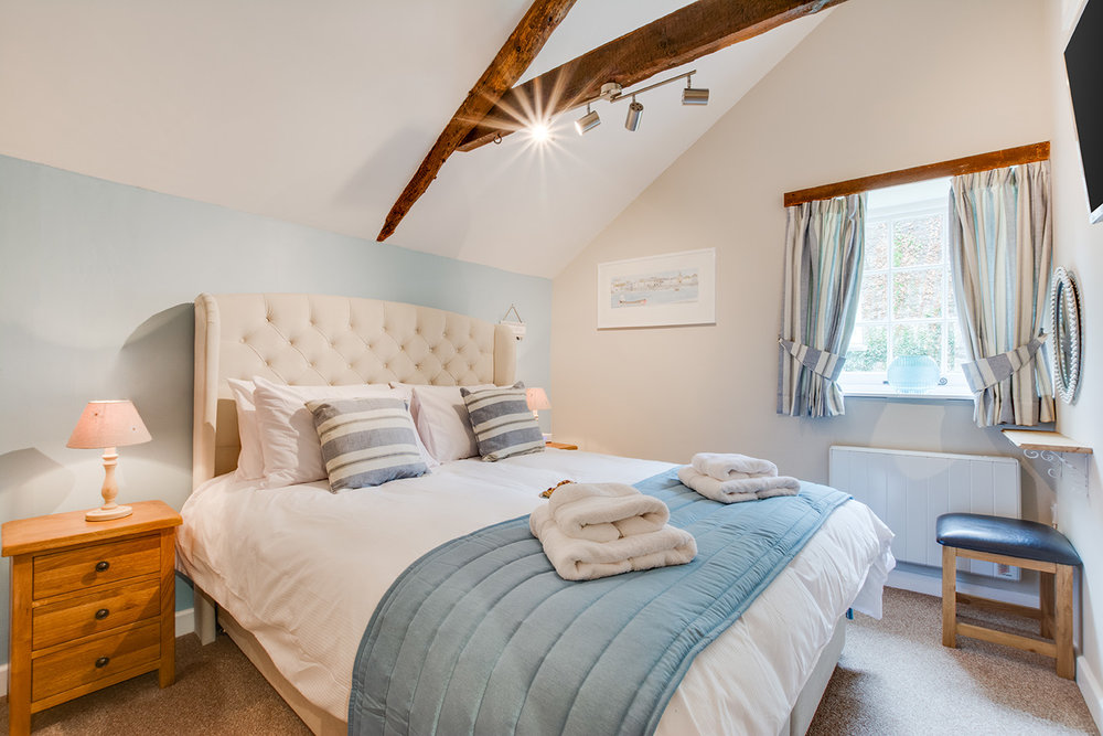 The master bedroom of Snappers luxury self catering converted barn holiday cottage at Penrose Burden in North Cornwall 01.jpg