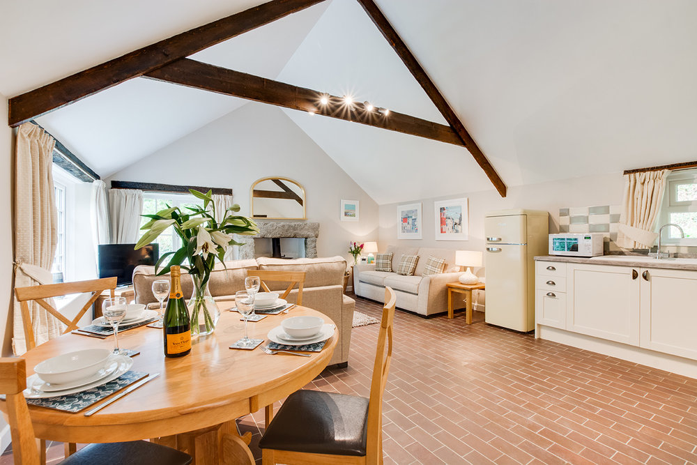 The dining area of Troutstream luxury self catering converted barn holiday cottage at Penrose Burden in North Cornwall 01.jpg