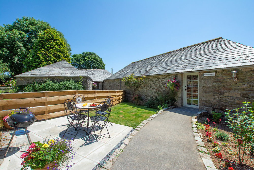 The exterior of Otterbridge luxury self catering converted barn holiday cottage at Penrose Burden in North Cornwall 01.jpg