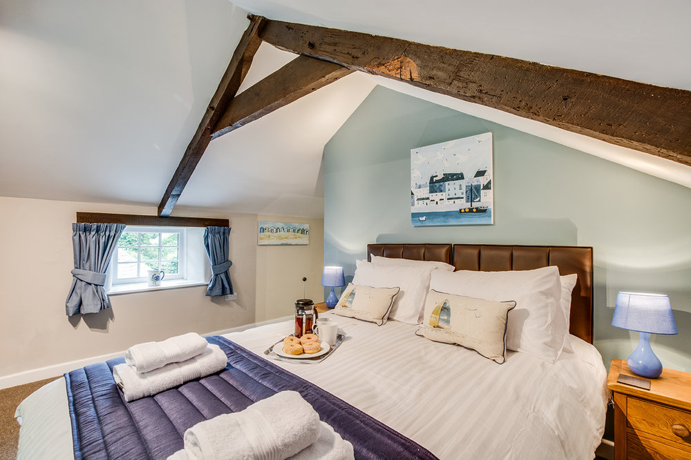Double bedroom 2 of Troutstream luxury self catering converted barn holiday cottage at Penrose Burden in North Cornwall 01.jpg