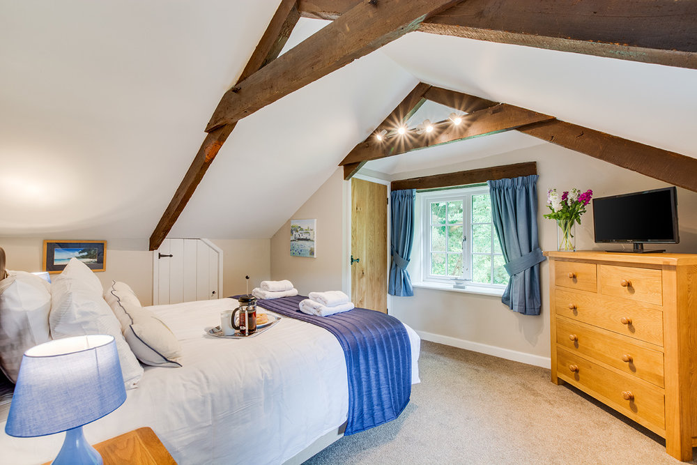 Double bedroom 2 of Troutstream luxury self catering converted barn holiday cottage at Penrose Burden in North Cornwall 02.jpg