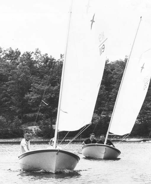 Petrels racing at a J965 July 4  th Regatta. Bob Chambers skippers the lead boat with Barbara Ostberg as crew. Len Wilson skippers the second boat with Arnold Whitman as crew.