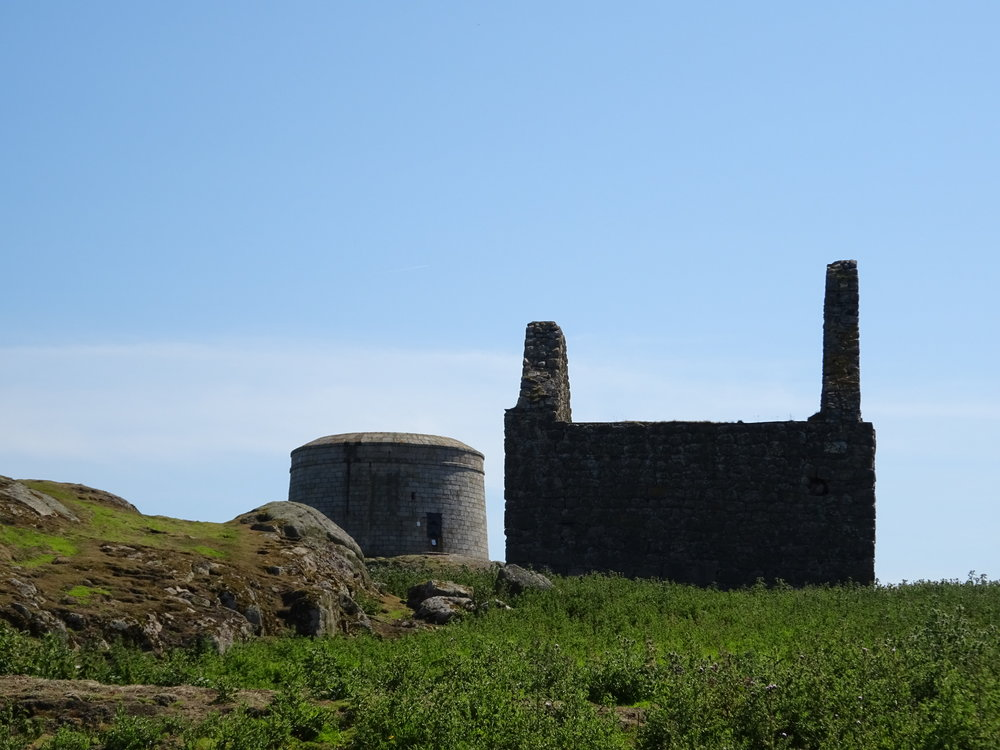 Martello tower in the background with St Begnet's church in the foreground.