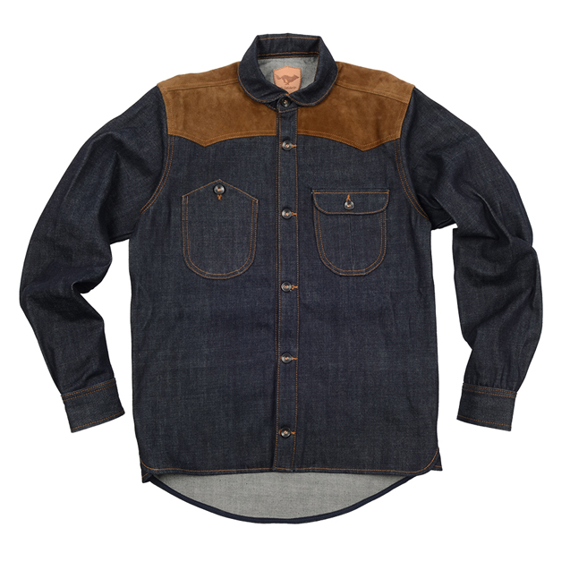 EL SOLITARIO VANDAL OVERSHIRT    El Solitario Vandal is not a jacket, not a shirt, it is our vision of an overshirt, which is a more versatile garment than any of the others. Wear it over other clothes and/or between layers. Hand built out of raw 14oz. denim with suede shoulders for extra ruggedness. You will dig its secret deep inner pockets to carry your most precious goods in disguise.  Now also available in Black.