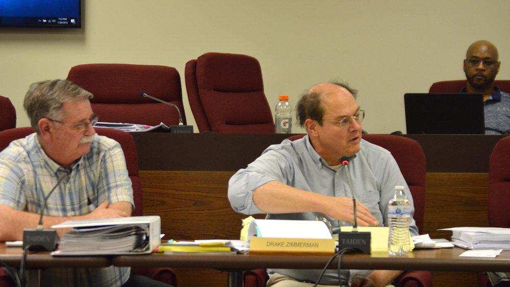 Members of The McLean County Zoning Board of appeals deliberated for nearly three hours before a unanimous vote to recommend approval of Invenergy's proposed wind farm. (Image Credit: Breanna Grow)