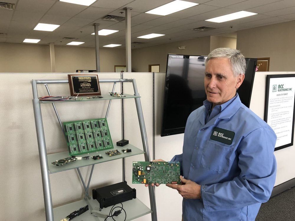 John Franklin, President of ACC Electronix, Inc., shares various aspects of the electronics business with AdaptBN. (Photo Credit: Erik Prenzler)